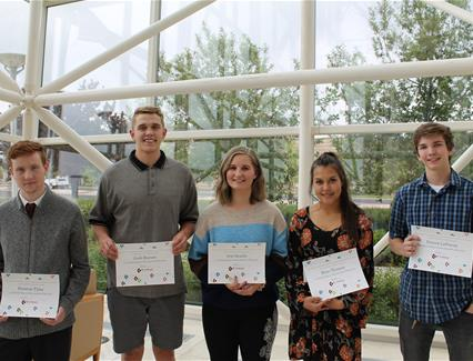 High school scholarship winners with their certificates